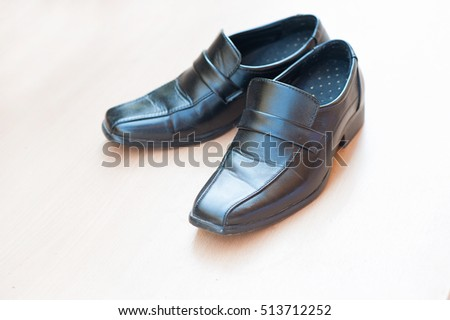 vintage black shoes with wooden background