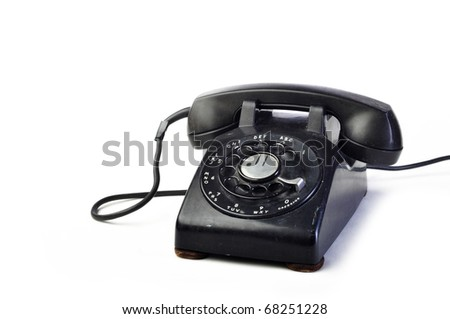 Vintage black telephone isolated on white background