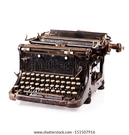 Vintage black typewriter isolated on white background. - stock photo