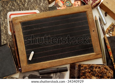 Vintage blackboard and other children objects - stock photo