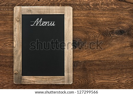 vintage blackboard with text Menu on wooden background - stock photo