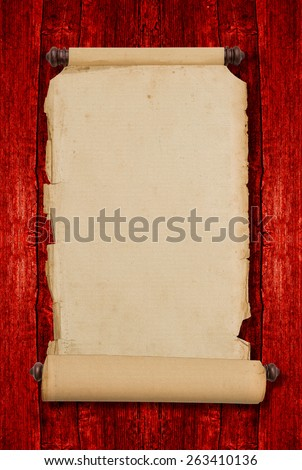 Vintage blank aged paper scroll on red wooden background with copy space. Antique style parchment manuscript - stock photo