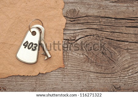vintage blank paper and keys on wooden background with place for your message