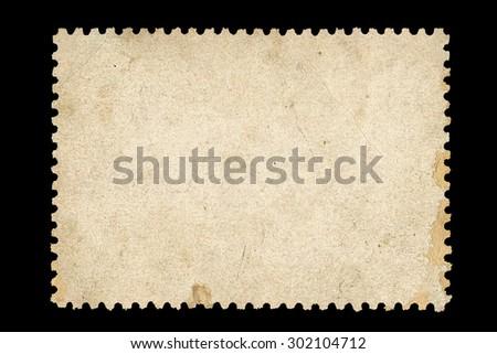 Vintage blank postage stamp on a black background - stock photo