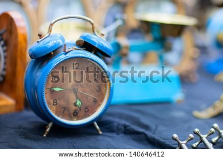 Vintage blue alarm clock at flea market - stock photo