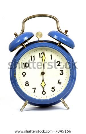 vintage blue clockwork alarm clock showing 6 o'clock - stock photo