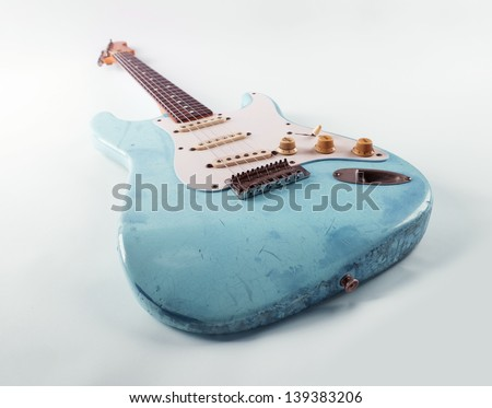Vintage blue guitar with worn and battered lacquer finish - stock photo