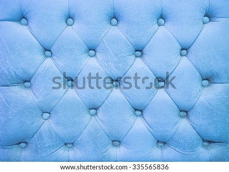 Vintage blue sky leather upholstery buttoned sofa (background) - stock photo