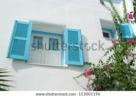 Vintage blue window on the white wall  - stock photo