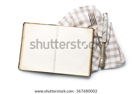 vintage book and cutlery on white background - stock photo