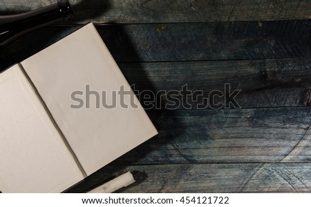 Vintage book, open, on old wooden table. - stock photo
