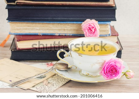vintage  books and mail with antique cup of tea - stock photo