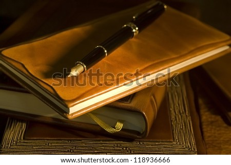Vintage books and pen (selective focus) - stock photo