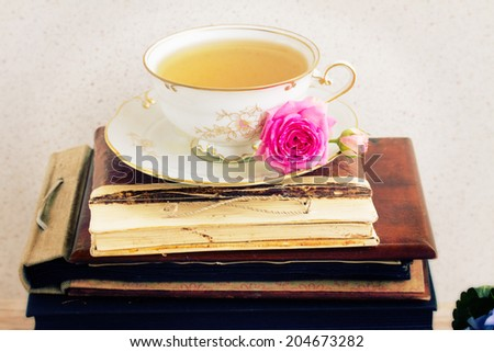 vintage  books,  antique cup of tea and rose flower - stock photo