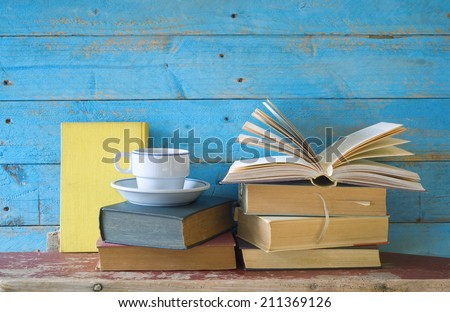 vintage books with a cup of coffee, free copy space  - stock photo
