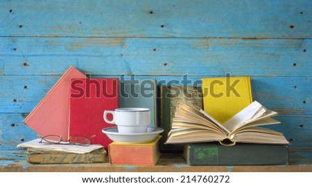 vintage books with coffee cup and spectacles, free copy space  - stock photo