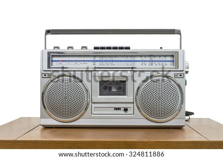 Vintage boombox on wood table isolated on white. - stock photo