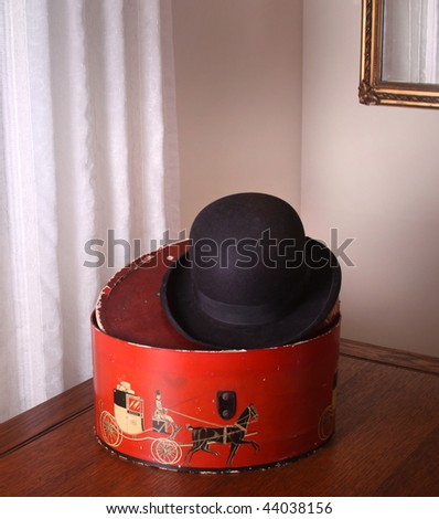 Vintage bowler hat and box. - stock photo