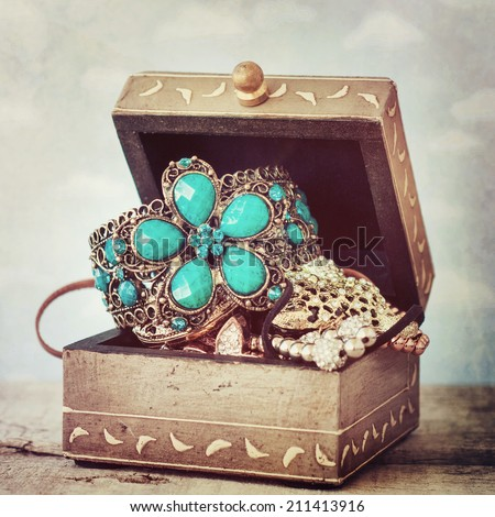 Vintage box with jewelry - stock photo