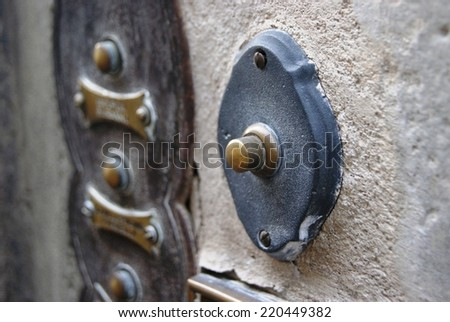 Vintage Brass and Copper Doorbell and Nametags - stock photo
