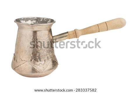 Vintage brass coffee pot with wooden handle isolated on white background
