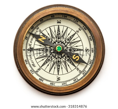 Vintage brass compass on background in closeup - stock photo