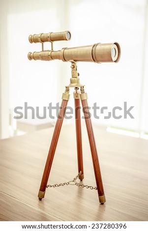 vintage brass telescope - stock photo