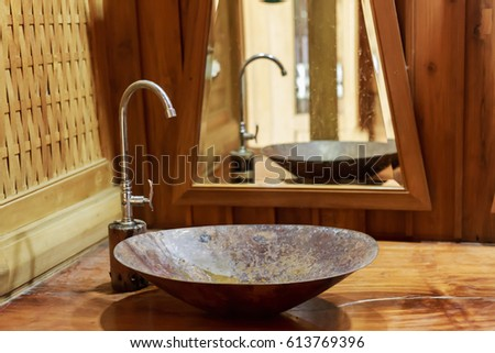 Vintage Brass Wash Basin And Faucet In Wooden Bathroom.