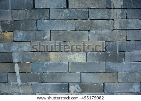 Vintage brick block soft dark color background texture