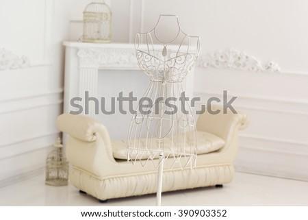 Vintage bridal metal hanger in dress shape form - stock photo