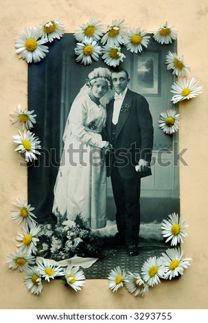 Vintage bridal pair with daisies - stock photo