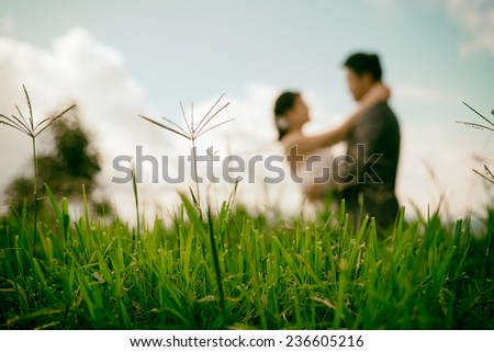 vintage bride and groom standing in rice field. - stock photo