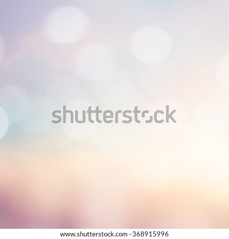 vintage bright blurred sunset beach background with bokeh motion light:blurry tropical summer sky backdrop concept:beauty sunshine aerial wallpaper with circle bulbs:peaceful morning sunrise ideal. - stock photo