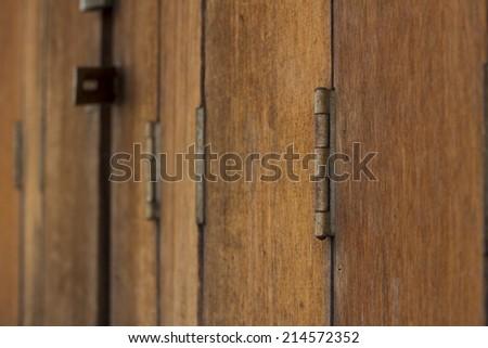vintage brown wooden door close-up - stock photo