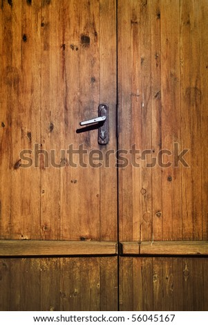 vintage brown wooden door close-up - stock photo