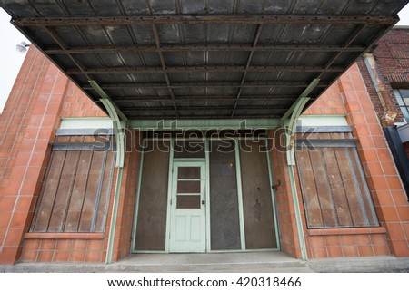 vintage building entrance in taylor texas - stock photo