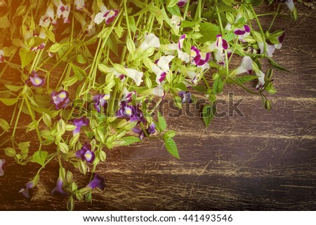Vintage bunch of flower on grunge wooden table with copy space