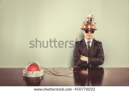 Vintage businessman with alert light sitting at office desk - stock photo