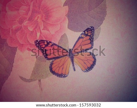 Vintage butterflies on flowers background - stock photo