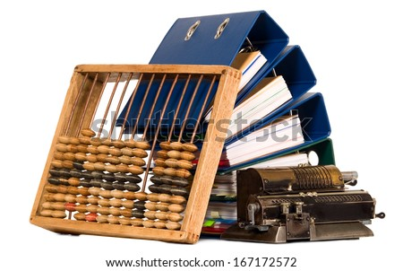 Vintage calculator and abacus placed near bunch of papers, document files - stock photo
