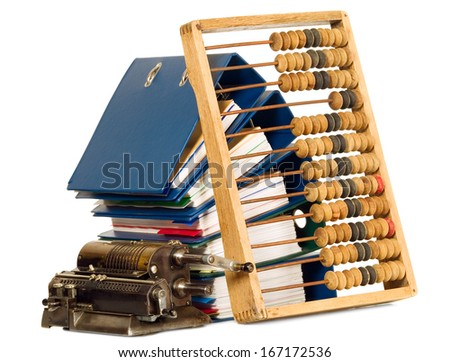 Vintage calculator and abacus placed near bunch of papers, documents - stock photo