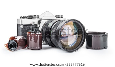 Vintage camera and film isolated on a white background - stock photo