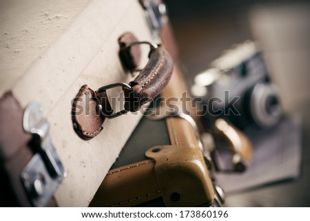 Vintage camera and old worn-out suitcase, travel concept. - stock photo