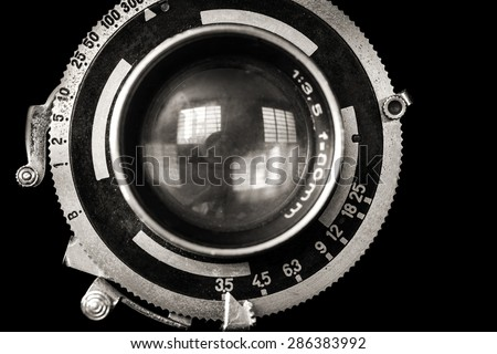 Vintage camera lens close-up isolated on black - stock photo