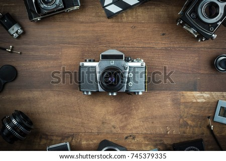 stock-photo-vintage-camera-on-a-wooden-b