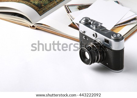 Vintage camera on isolated white background. - stock photo