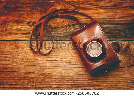 Vintage camera on old wooden background