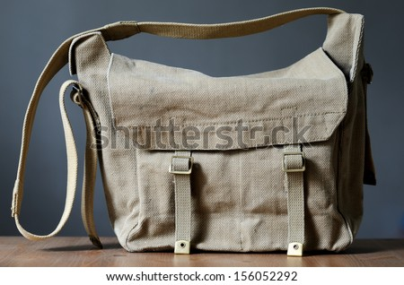 vintage canvas bag on a gray background - stock photo