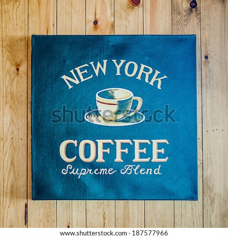 Vintage canvas sign - New York Coffee on wooden wall - stock photo
