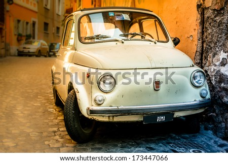 Vintage car on the street of Rome. Street view from the old city of Rome. Vintage vehicle parked on the street of Rome. - stock photo